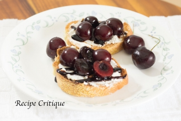 Balsamic poached cherry and goat cheese crostini